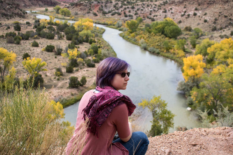Sophomore Photography Major Willow Howell overlooking the Chama river on the photography department field trip. Photo credit: Chris Dorantes