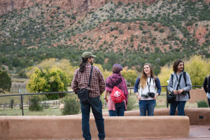 Photography Professor Chris Nail (left) and photography students Willow Howell, Makenna McLeod, and Tyler Abell at the Christ in the Desert Monastery at the Chama river canyon. Photo credit: Chris Dorantes