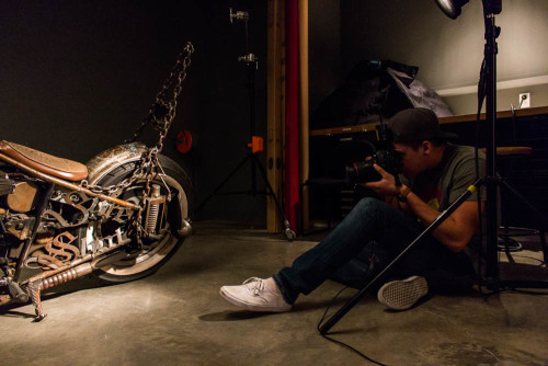 Photo student Jason Stilgebouer shooting a motorcycle in the studio. Photo by Yoana Medrano.