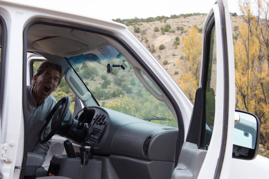 Tony O'Brien, head of the Department of the Photographic Arts, making a silly face from inside SFUAD's white van along the Chama River. Photo by Cris Galvez.