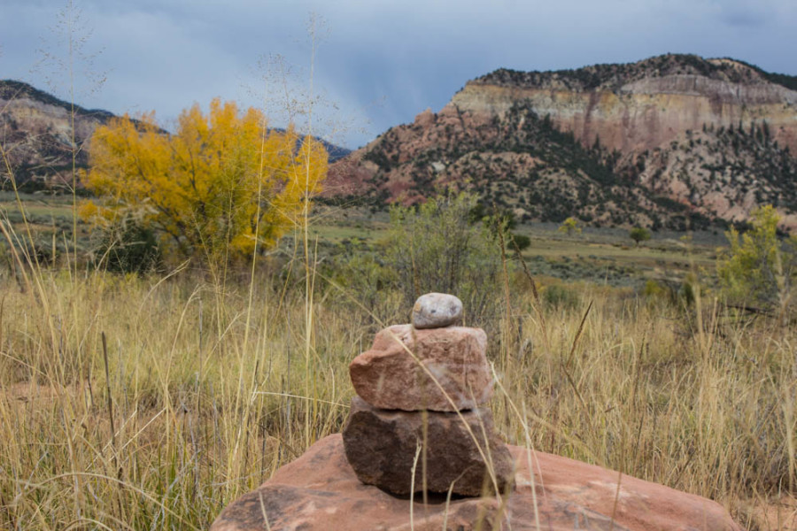 A small stack of rocks with the fall colors in the background near the Chama River Canyon. Photo by Cris Galvez.