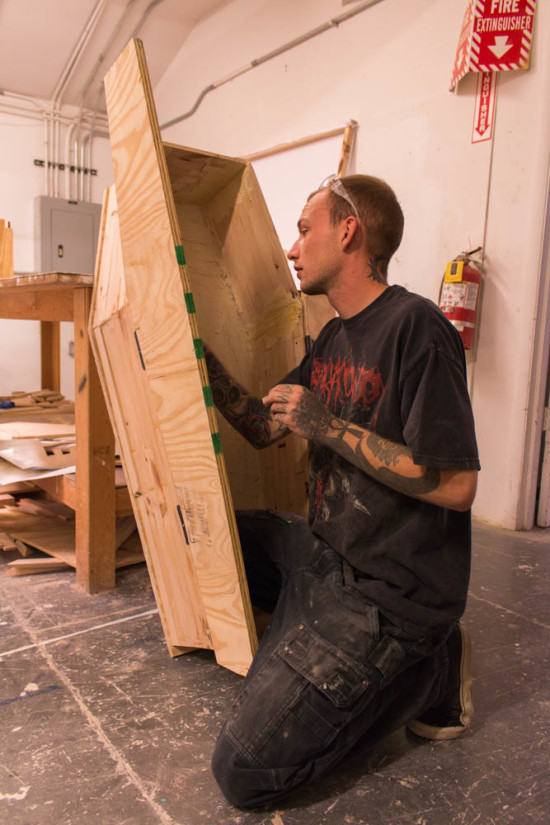 Freshmen Studio Arts Major Travis Dale working on his coffin piece during midterms week. Photo by Yoana Medrano.