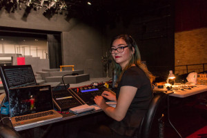 Senior Technical Theater Major Annie Haynes changing the lighting on stage. Photo by Yoana Medrano.