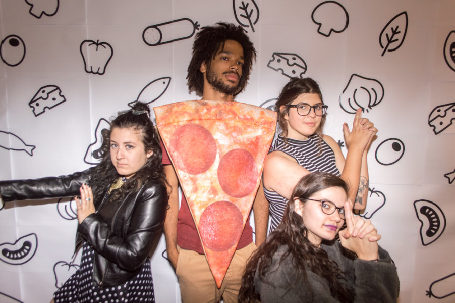 "(From left to right) Graphic Design Seniors Callan Ramirez, Julian Williams, Mariah Romero, and Syndey Rayne pose for the ""Another Show about Pizza"" photobooth. Photo by Jennifer Rapinchuk"