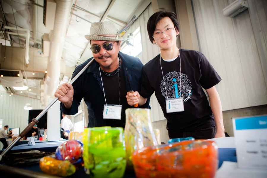 YQ Wheaton and Ira Lujan show off their glassblowing skills. Photo provided by Inspire Santa Fe
