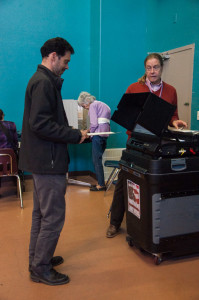 Paul Hedrick about to insert his ballot. Photo by Sasha Hill