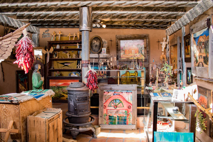 A local gallery and antique store in the Plaza del Cerro (plaza by the hill) above the historic El Santuario de Chimayó in Chimayo, NM. Photo by Chris Dorantes