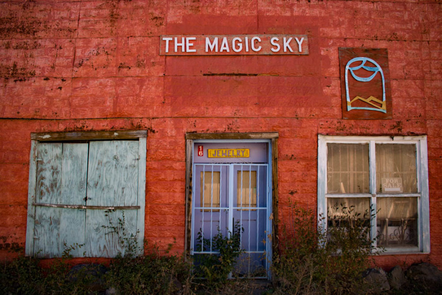 A rundown storefront now for sale on the plaza in Rancho de Taos near Taos, NM. Photo by Chris Dorantes