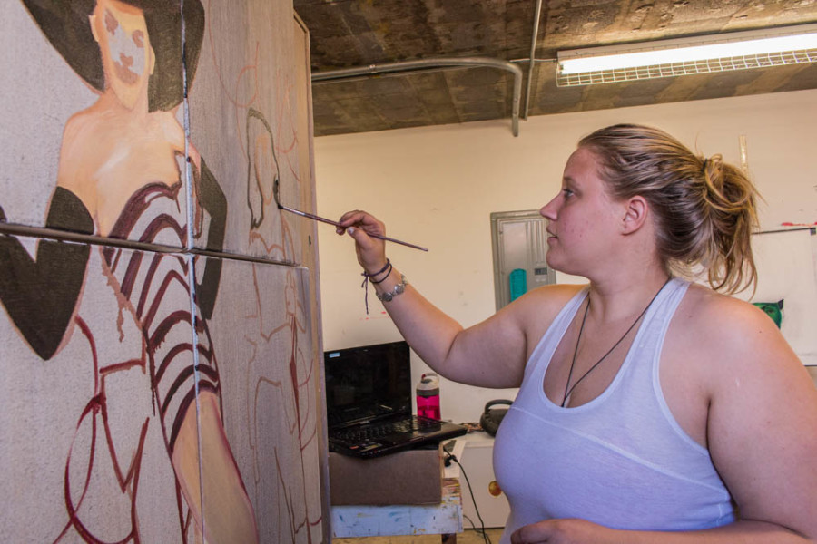Sophomore Studio Arts major Shasta Scott painting on a canvas for her advanced painting class. Photo by Yoana Medrano.
