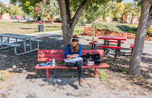 Sophomore Contemporary Music major Leidy Gonzalez studying between classes under the trees on the quad. Photo by Yoana Medrano.