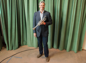 With his trumpet in hand and his desire to utilize music to travel the world, trumpet soloist and member of the Board of Directors at Santa Fe University of Art and Design, Bill Williams is rarely in one place for a long period of time. Photo by Jennifer Rapinchuk