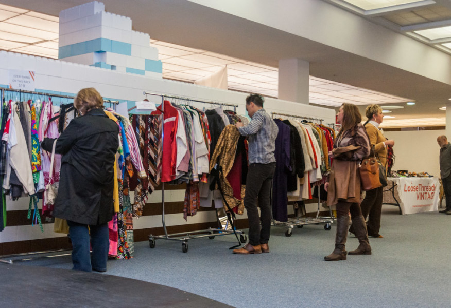 Shoppers enjoy browsing vintage threads inside Fogelson Library. Photo by Sasha Hill
