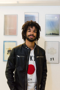 Senior Graphic designer Julian Williams. Photo by Sasha Hill