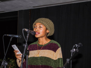 Valencia Lusk recites her poem during the Painters, Poets and Musicians at Fogelson Library on Dec. 3.