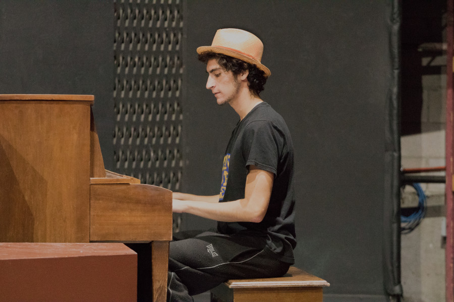 Sophomore Performing Arts major Niko'a Salas plays the piano in Shakespeare's Twelfth Night. Photo by Chris Dorantes