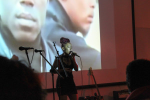 Kala Jones sings passionately at Power to the People: Artists United on Dec. 9 in Tipton Hall. Photo by Chantelle Mitchell.