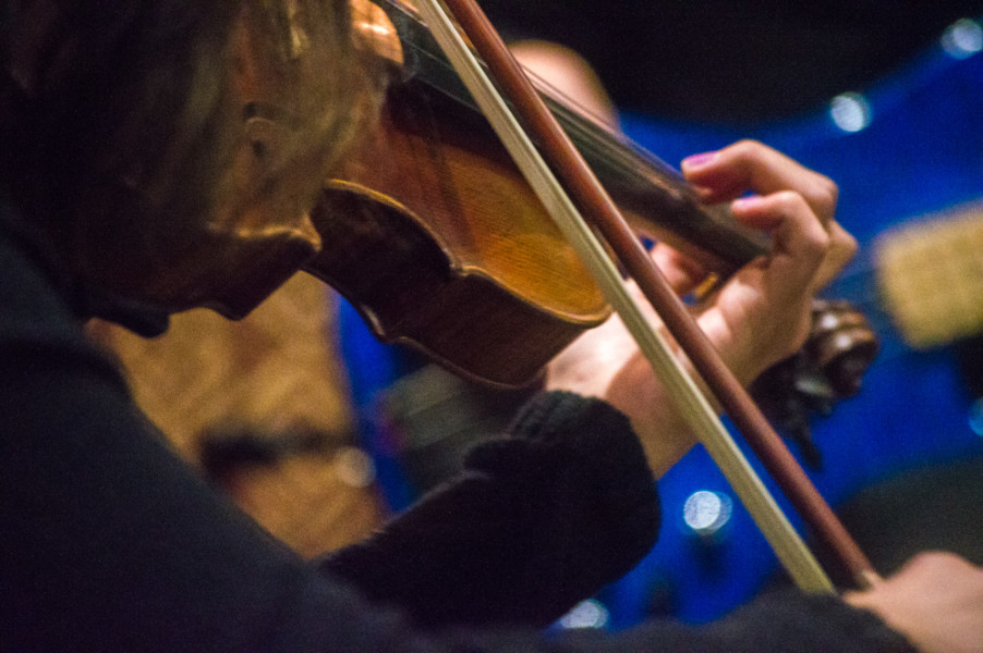 Jeanette Dominguez plays away at her violin during Maria Siino's first piece. Photo by Jennifer Rapinchuk.