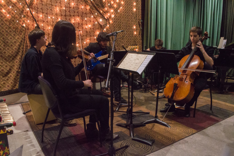 "Five students and one professor performed the first piece of the night ""Springtime Piecemeal"" with percussion, a violin, an electric bass, an electric guitar, a cello, and a piano. Photo by Jennifer Rapinchuk."