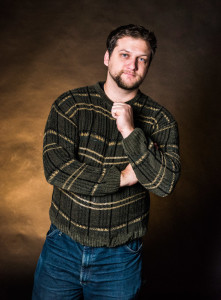 Creative writer Andrew Koss owns nice sweaters. Photo by Sasha Hill