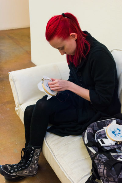 Junior Photography major Christina Marshall is sewing her cyanotypes. Photo by Sasha Hill