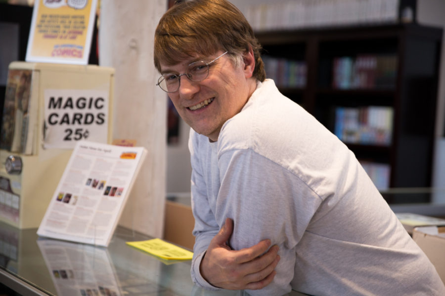 Kevin Drennan, owner of Big Adventure Comics, leans on the counter where he greets customers daily. Photo by Jason Stilgebouer