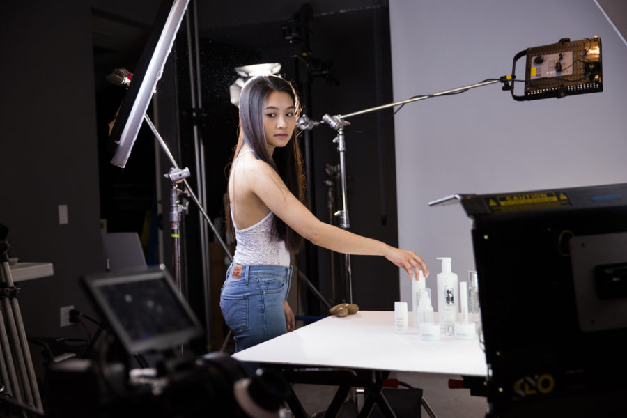 Vietnamese music artist Hoang Thuc Linh Places her products for her her beauty commercial. Photo by Jason Stilgebouer.