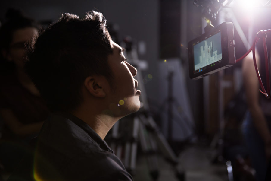 Director of photography Phillip Hoang checks the monitor on the camera for the still product shots. Photo by Jason Stilgebouer