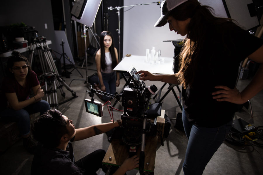 Director of photography Phillip Hoang and assistant camera Alejandra Castro line up the next shot for the products. Photo by Jason Stilgebouer.