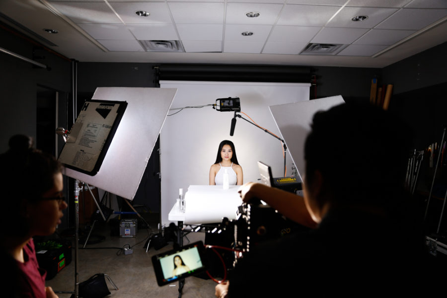 Vietnamese music artist Hoang Thuc Linh Poses with her products for her her beauty commercial. Photo by Jason Stilgebouer.