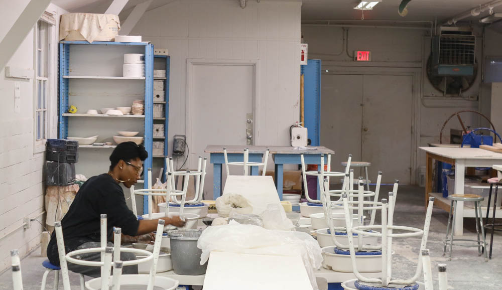Studio Arts sophomore Elisis Miller works alone in the barracks. Photo. by Jesus Trujillo.