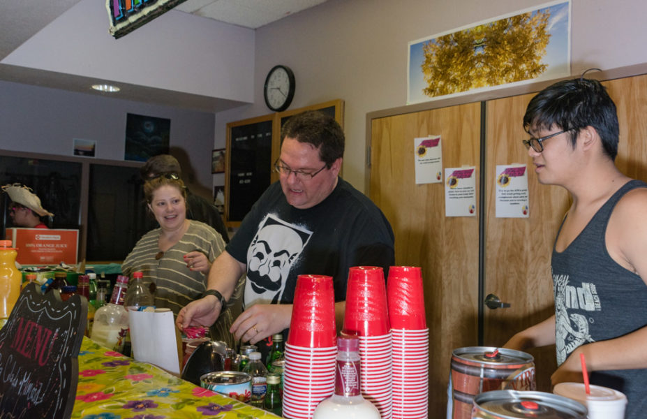 Shawn Khounphithack (right), Timothy Chambers and Heather Mazarow are bartenders taking orders for mixed drinks at the beach bash. Photo by Sasha Hill