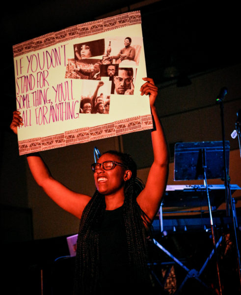 Cabria Scott holds up a sign for Black history month celebration. Photo by: Hawie Veniegas