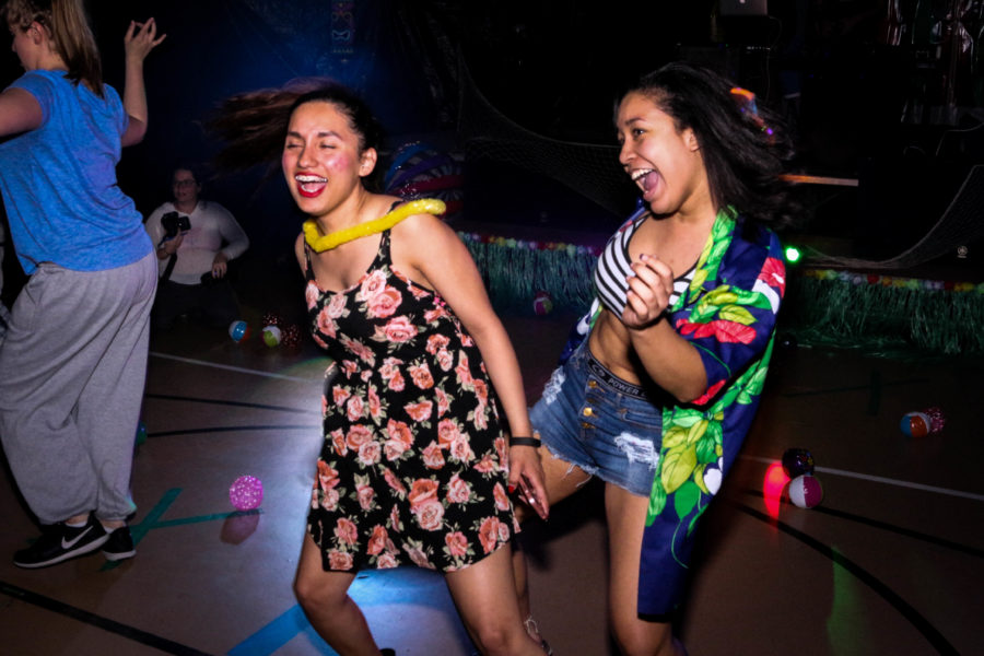 Laura Leal and Analyss Robles laughs and dances to the rhythm of the music. Photo by Hawie Reyne Veniegas.