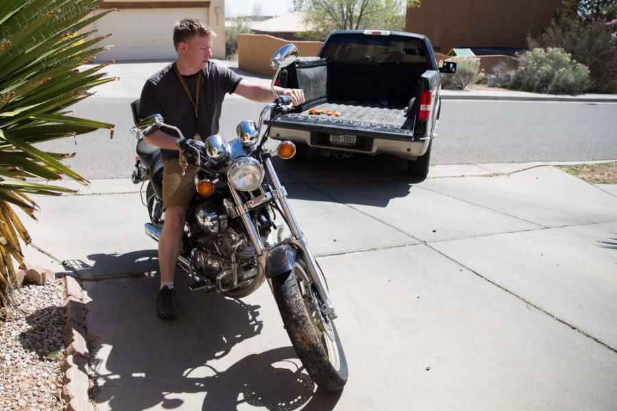 Ambrose Taylor moves his motorcycle as he prepares to take it back to campus. Photo by Jason Stilgebouer