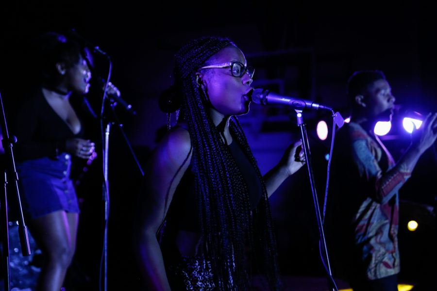 Cabria Scott performing alongside Amber Edwards and Jeremiah Smith for Black History month. Photo by Jason Stilgebouer