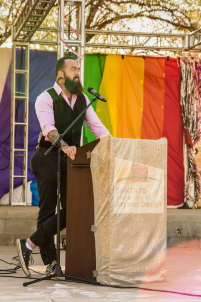 Santa Fe Pride representative James Brethour gives speech over history of Santa Fe Pride and the new app. Photo by Sasha Hill