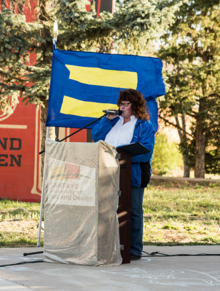 Linda Krauss giving her speech about the foundation and evolution of the PRIDE flag. Photo by Sasha Hill