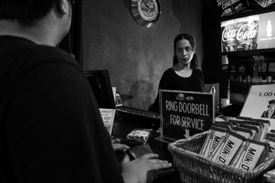 Omar Hilario purchases snacks for his companions before the show starts. Photo by: Hawie Reyne Veniegas