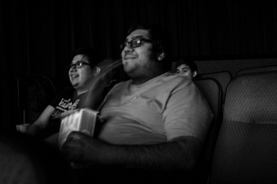 "Warren Couvillion (right) and Omar Hilario founders of Club-Along joyfully watches ""The Lion King"" with the rest of the students. Photo by: Hawie Reyne Veniegas"