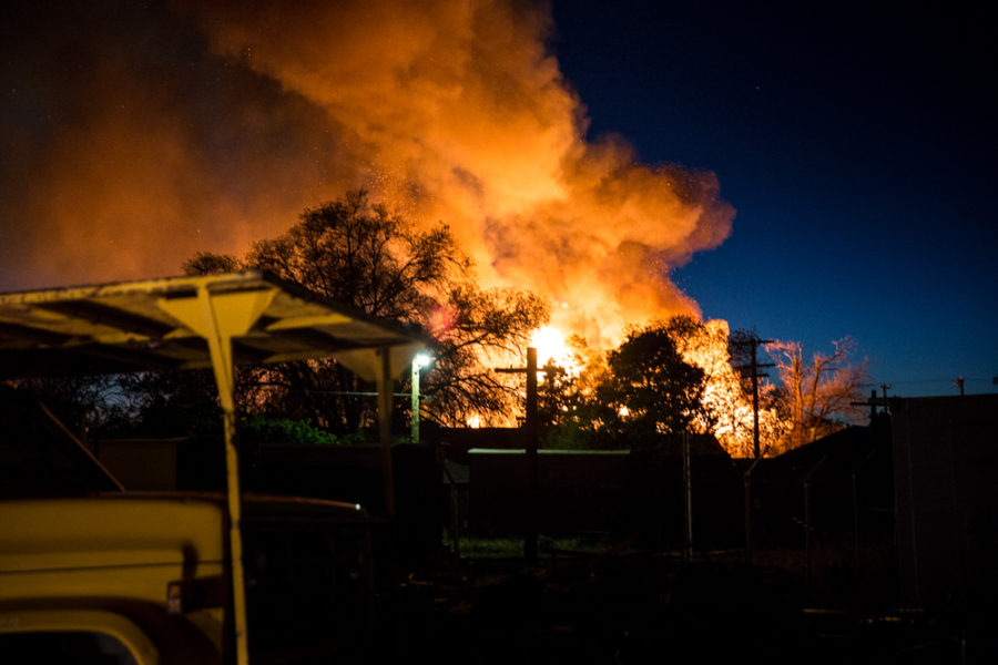 Old army barracks bursts catch fire as the fire could be seen from the distance. Photo by Jason Stilgebouer
