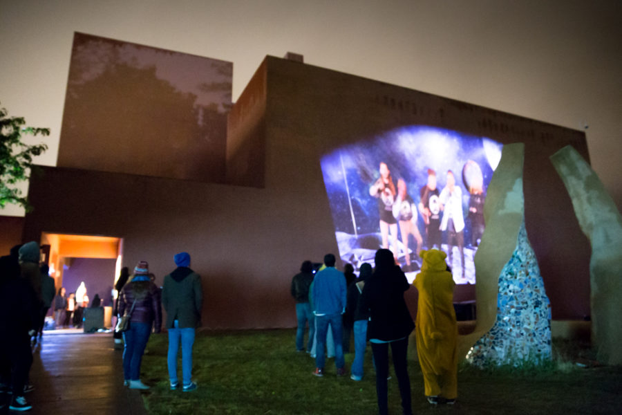 Student band Space Mob records live at the outdoor vision festival, the performance is projected on the side of the building. Photo by Jason Stilgebouer