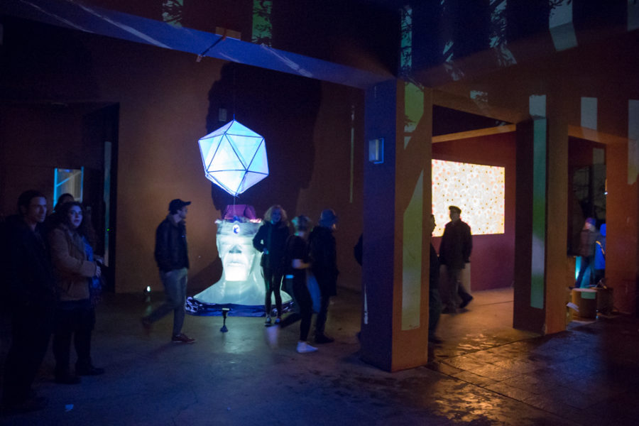 People gather at outdoor vision festival to look and interact with art pieces. Photo by Jason Stilgebouer