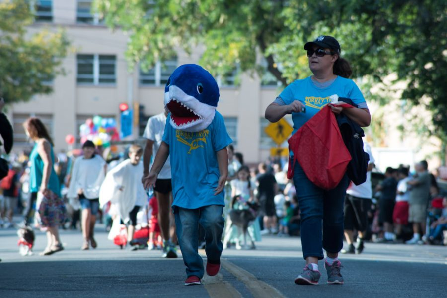 Shark Boy tossing out candy. Photo by Sasha Hill