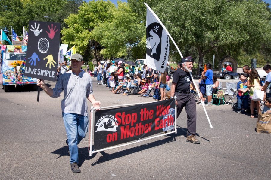 The Veterans for Peace organization moves down Gaudalupe Street during the  Historical/Hysterical Parade during Fiestas on Sept. 10. Photo by Jason Stilgebouer