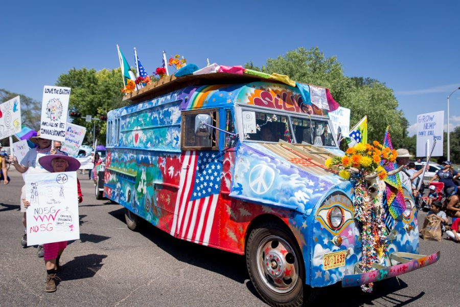 The Veterans for Peace retro bus as it moves down Guadalupe Street during the  Historical Hysterical Parade during Fiestas on Sept. 10. Photo by Jason Stilgebouer