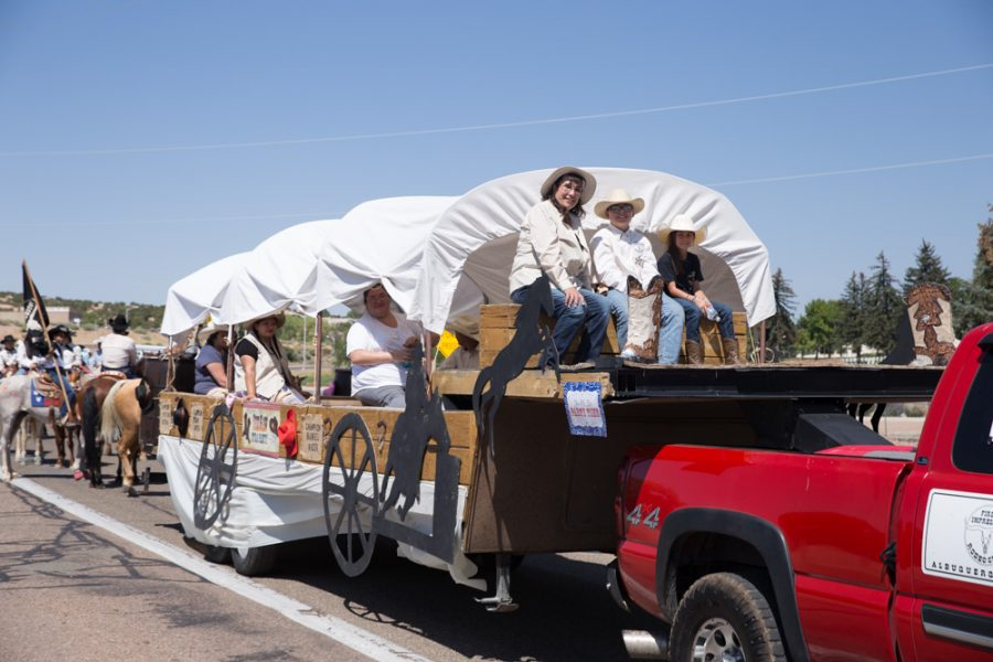 The Albuquerque Rodeo brings up the rear end during the Historical Hysterical Parade during fiestas. Photo by Jason Stilgebouer