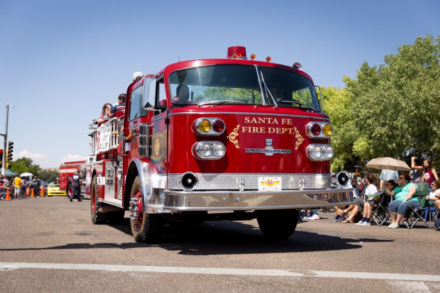 The Santa Fe Fire Department leads the Historical Hysterical parade during Fiestas. Photo by Jason Stilgebouer