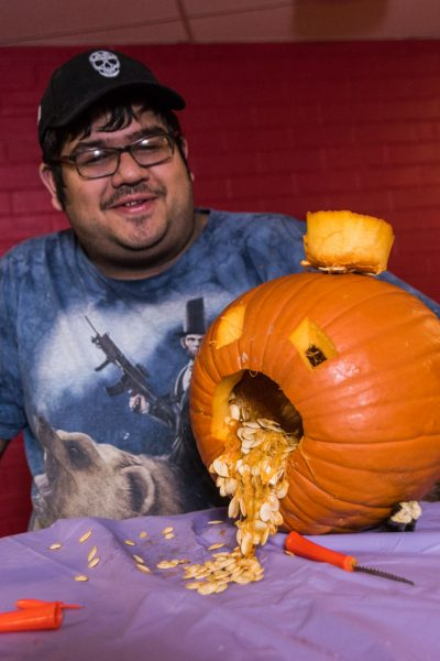 Warren Couvillion shares his drunken pumpkin. Photo by Sasha Hill