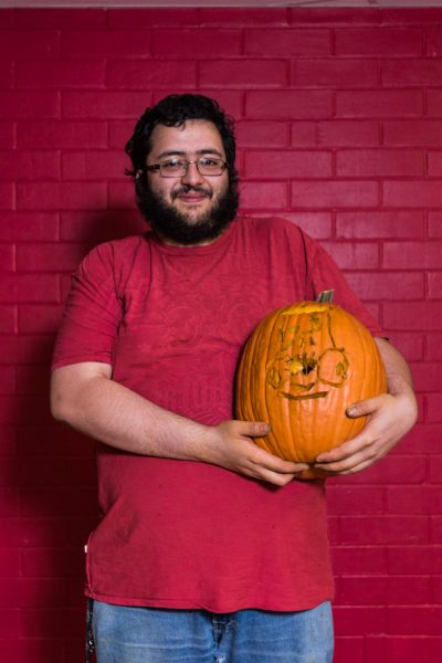 poses with his pumpkin. Photo by Sasha Hill