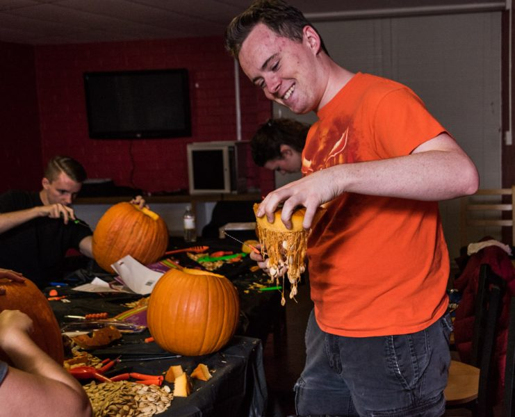 Jack Getschman hold up pumpkin guts. Photo by Sasha Hill